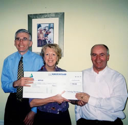 Lynn presents a cheque to ME Research UK