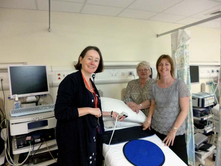 Trustee Jan McKendrick and Vice-Chair Sue Waddle examine the tilt-table used for autonomic nervous system testing