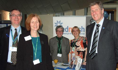 Dr Neil Abbot (ME Research UK), Joan Kerr (EDMESH) and Justice Secretary Kenny MacAskill MSP